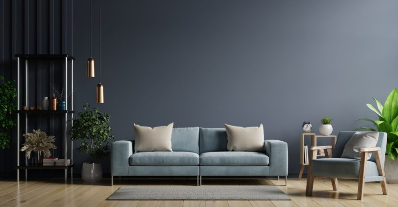 The interior has a sofa and armchair on empty dark wall background,3D rendering